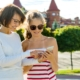 Parent and Teen On Mobile Device