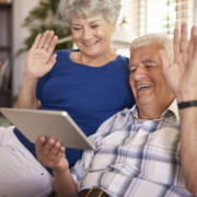 Grandparents Waving at Tablet Image
